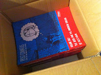 Box of copies of Alex Hahn's graphic novel Post Conatus