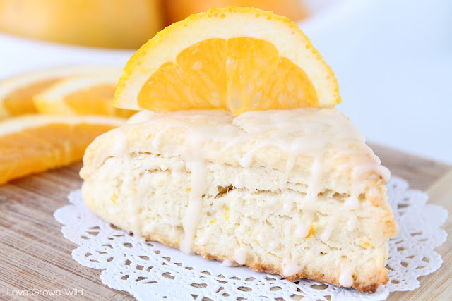 Glazed Orange Scones - a delicious treat filled with orange zest and drizzled with an orange glaze! via LoveGrowsWild.com