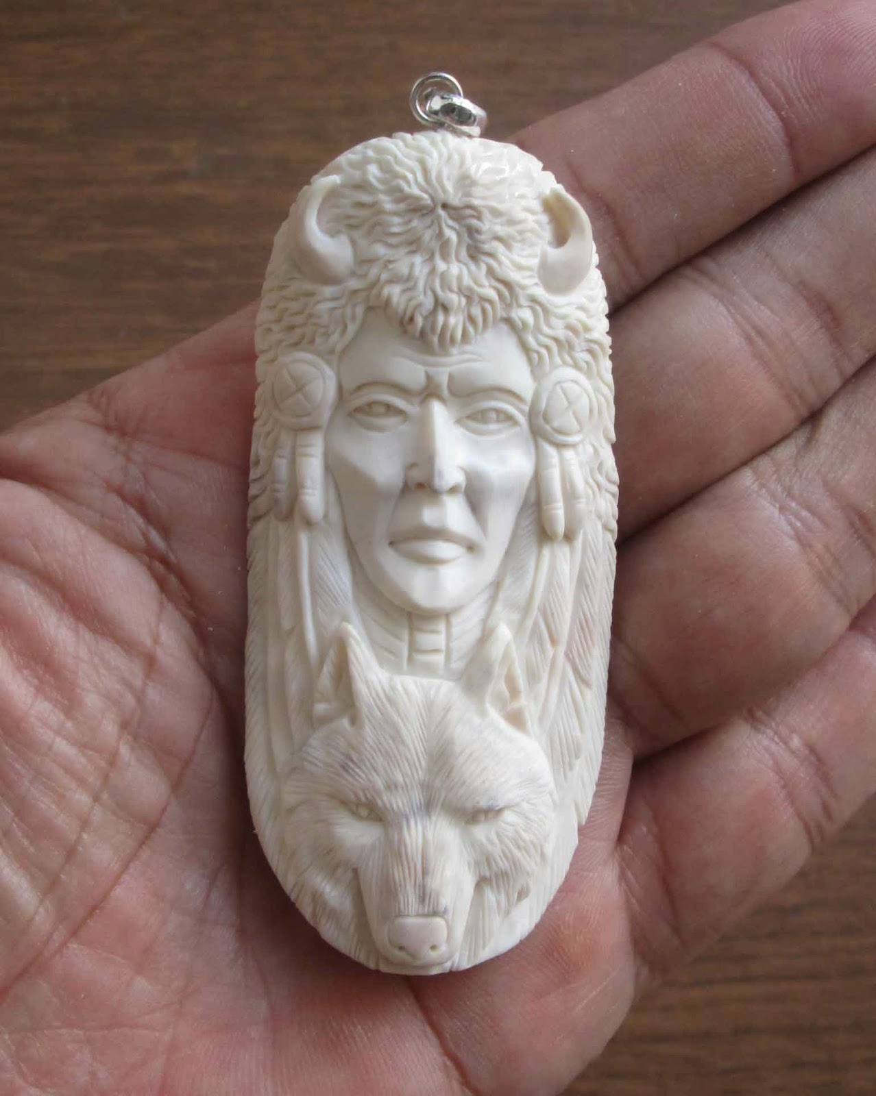 Hand carved indian animal bone pendants