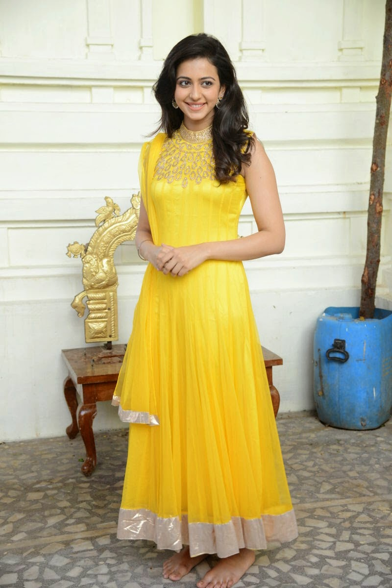 COOGLED ACTRESS RAKUL PREET SINGH IN CUTE YELLOW DRESS LATEST PICTURES
