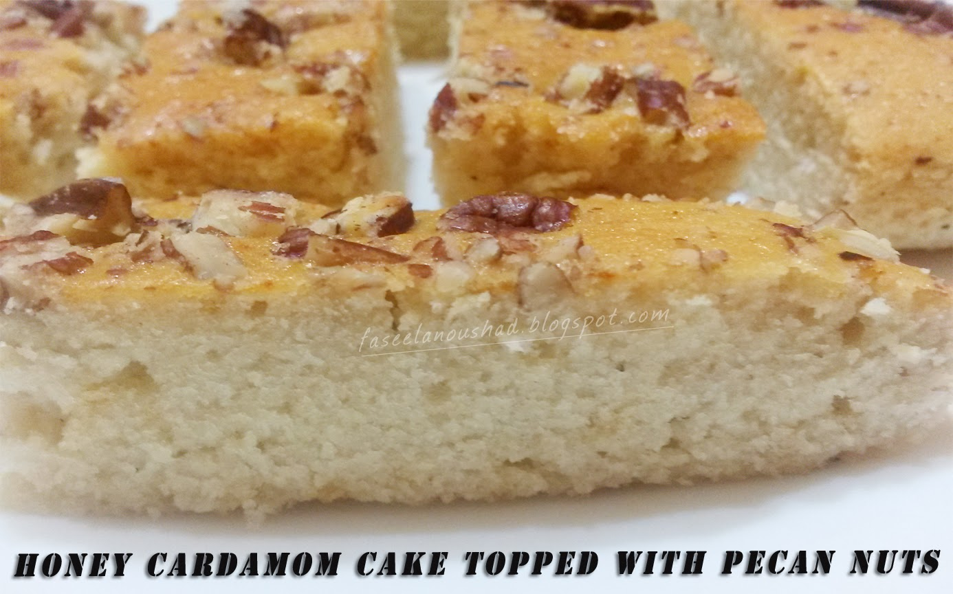 Honey Cardamom Cake Topped With Pecan Nuts