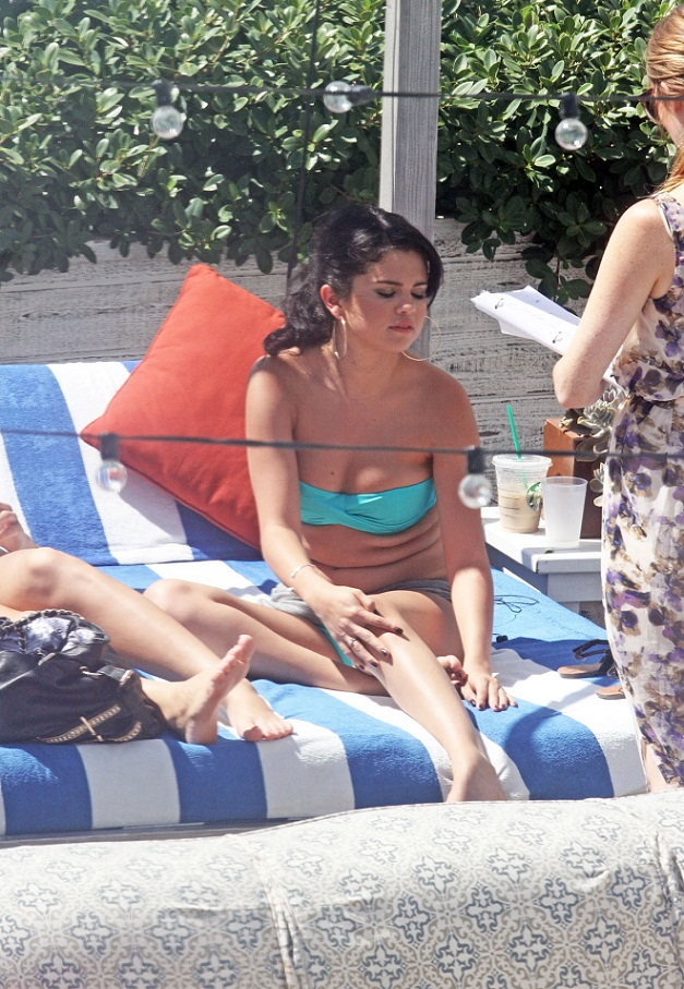 Selena Gomez is hot and bothered in a blue bikini in Miami