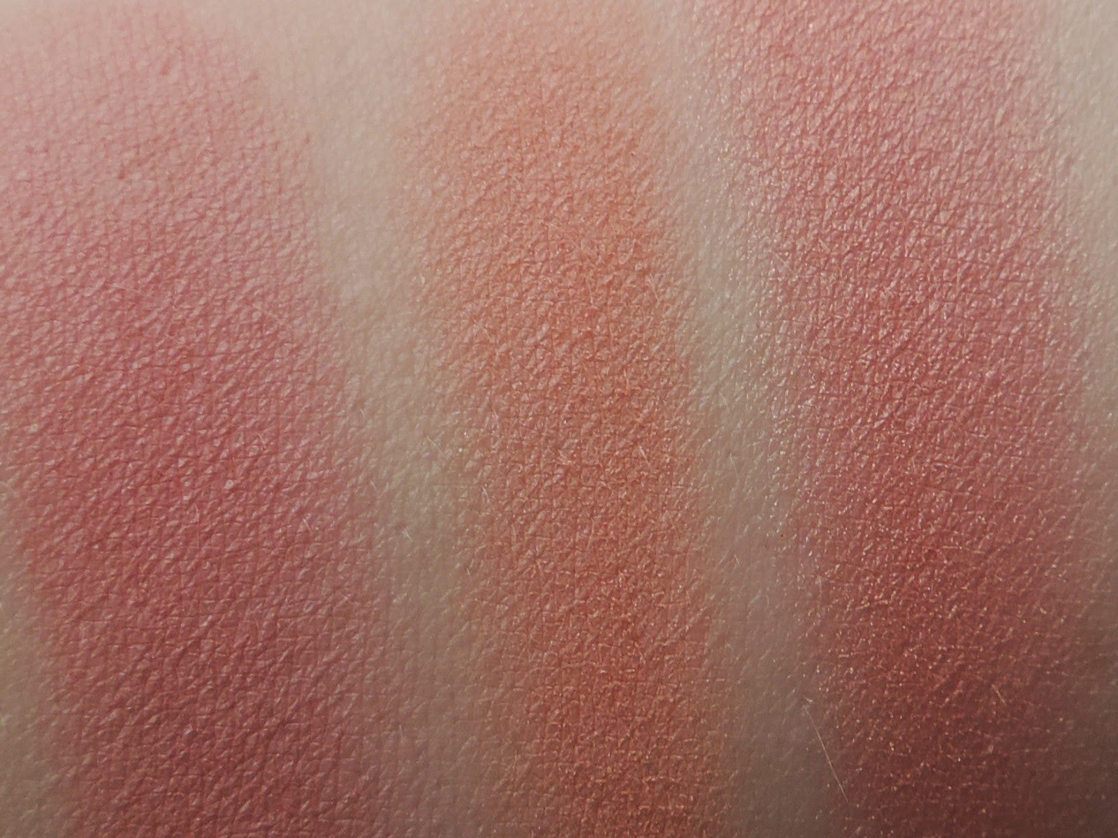 Swatches of Makeup Geek blush (from left) Spell Bound, Bliss, Romance