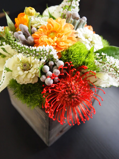 Ever ours events modern orange arrangements