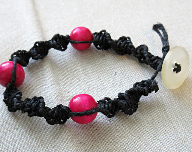 A black and hot pink DNA double helix spiral bracelet. Science jewelry makes a unique birthday or graduation gift for biology teachers or geneticists!