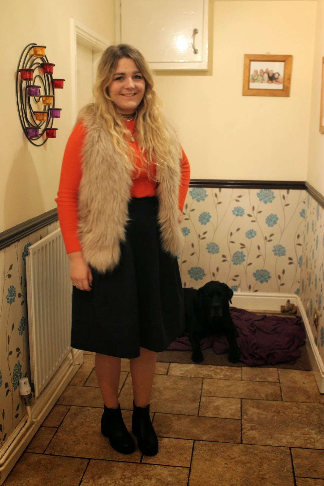 Fur gilet orange top black midi skirt