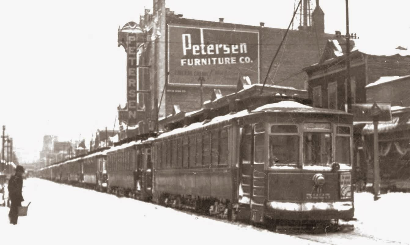 PHOTO   CHICAGO   66TH AND HALSTED   WINTER   LINE OF STREETCARS   PETERSEN  FURNITURE IN BACKGROUND   1939