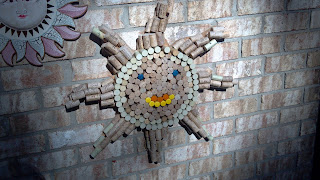 sun face made from wine corks
