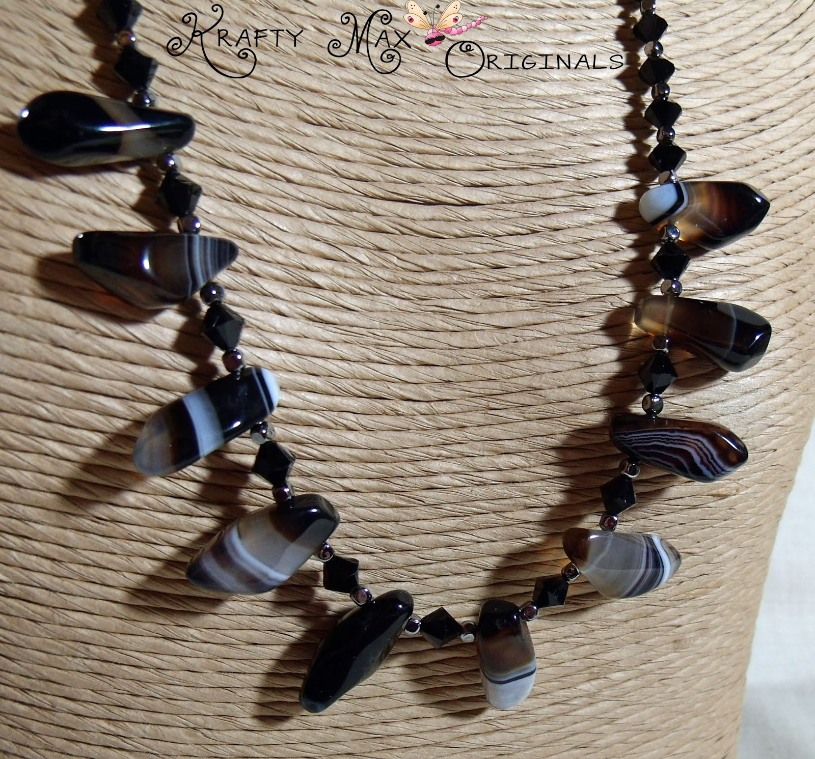 http://www.lajuliet.com/index.php/2013-01-04-15-21-51/ad/gemstone,92/exclusive-black-banded-agate-and-swarovski-crystals-necklace-set-a-krafty-max-original-design,128