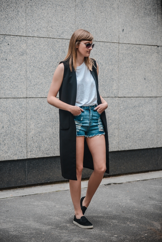 high waisted ripped shorts, longline black vest gilet, black hairy slip on sneakers plimsolls, style blogger, fashion blog