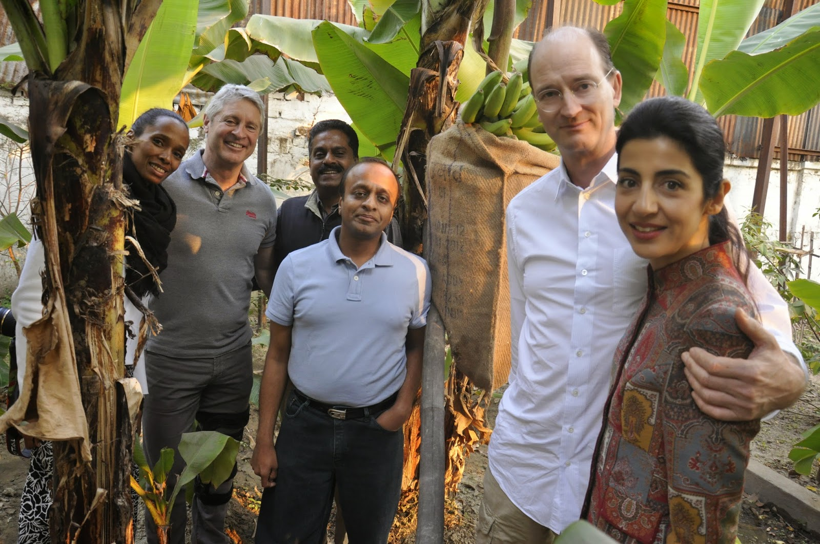 Philipp Schoeller with wife Sara Schoeller, Walter Raizner & Delphine Raizner, with Murli Khemka admiring the fruit trees at Mulvany House, Kolkata