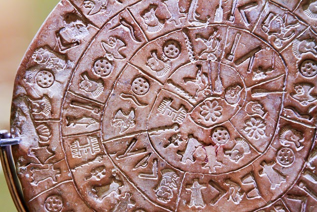 Decrypting the enigmatic Phaistos Disk