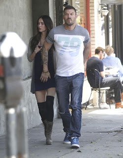 Brian Austin Green covering Megan Fox's belly thats starting to show