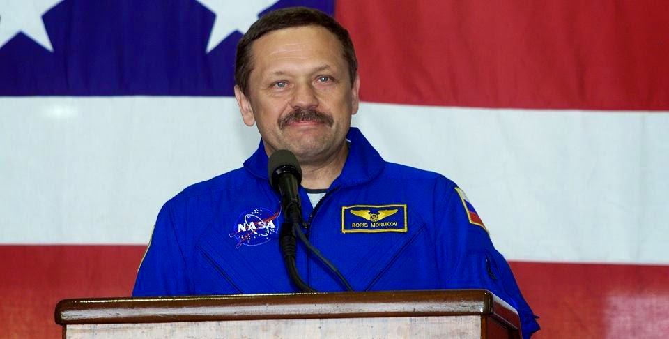 Cosmonaut Boris V. Morukov, STS-106 mission specialist representing the Russian Aviation and Space Agency, addresses the crowd that visited Ellington Field's Hangar 990 to welcome home the STS-106 astronauts (Sept. 21. 2000). Credit: NASA