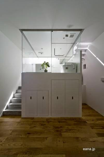 Interior planta baja baño a media altura