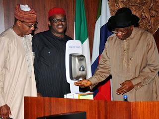 President Jonathan using hand sanitizer