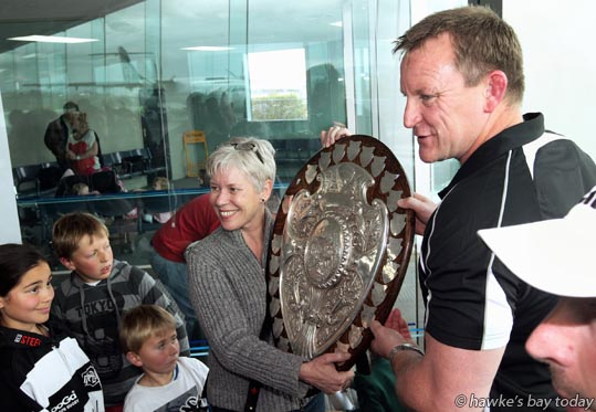 Anj Penrose, Napier, niece of Ian Penrose, the 1969 Canterbury captain who took the shield off Hawke's Bay; Craig Philpott, coach, Hawke's Bay Magpies rugby team, returning to Hawke's Bay Airport, Napier, with the Ranfurly Shield, after beating Otago 20-19 in Dunedin on Sunday. photograph