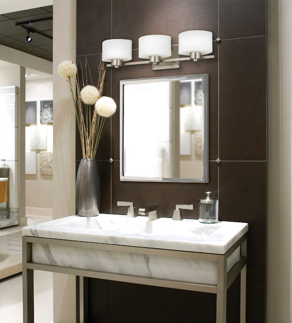 attractive white marble powder room vanities with three modern lamps and medium mirror