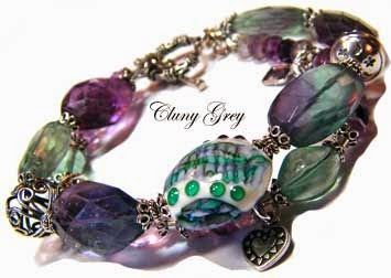 fluorite bracelet with lampwork bead and sterling silver