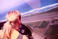 This is the story of the blonde flying in a two-seater airplane with just the pilot