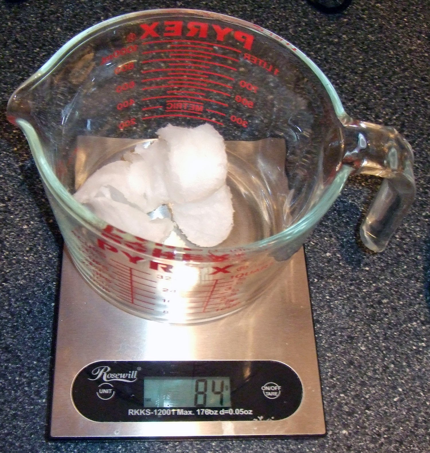 Coconut oil in measuring cup.