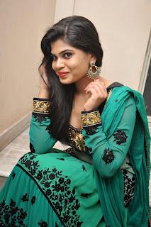 Actress Alekhya Pictures in Green Anarkali Long Length Salwar Kameez at Premisthe Poye Kaalam Audio Release Function  68.jpg