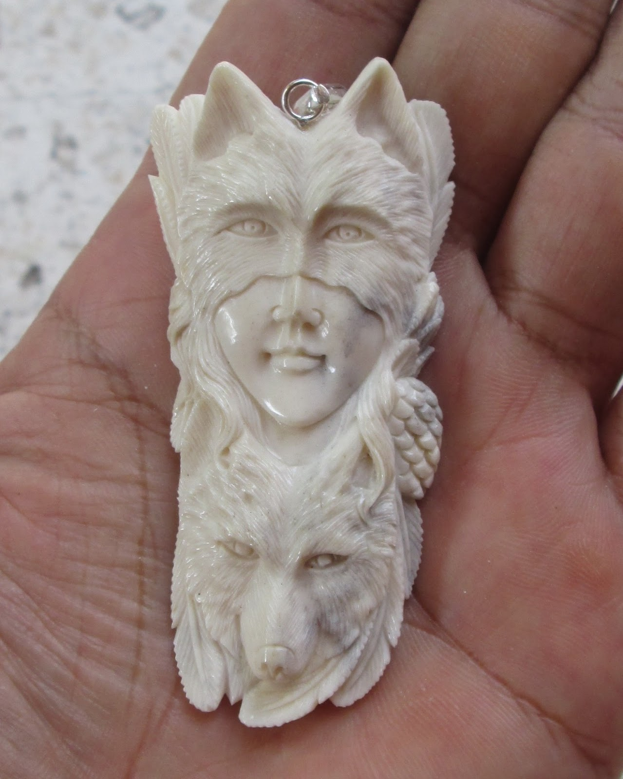 Wolf Mask Goddess Carved Bone Pendant with Wolf
