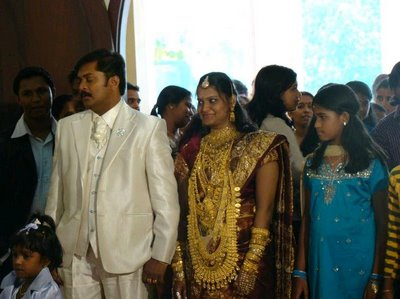 Kerala's bride in very very heavy gold jewellery