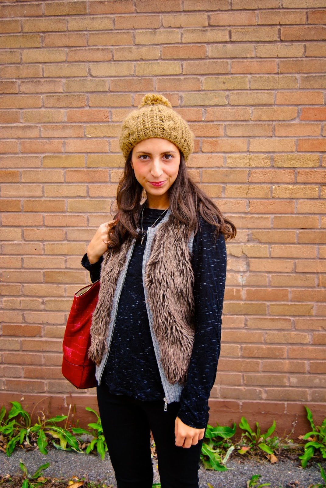 fall fashion fur vest red handbag tuque hat