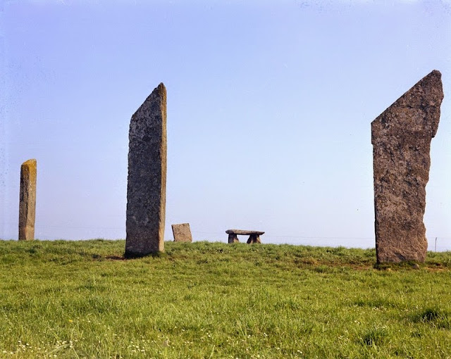 Standing Stones of Stenness, south-east end of Loch of Stenness. Orkney. The henge and stone circle have radiocarbon dates suggesting that Stenness was constructed during the 3rd. millennium B.C. Four thin, unshaped flagstones now survive, the tallest over five metres high; it is thought that there were originally twelve stones set in a circle about 30 metres in diameter. Ploughing has almost levelled the henge earthworks but the circle once stood within a ditch and bank, with an entrance causeway to the north. The henge and stone circle of Stenness together with the Ring of Brodgar and associated outlying stones and burial mounds form part of a great ceremonial complex in the heart of Orkney, comparable to Callanish on Lewis in the Western Isles and to Stonehenge on Salisbury Plain in Wiltshire.