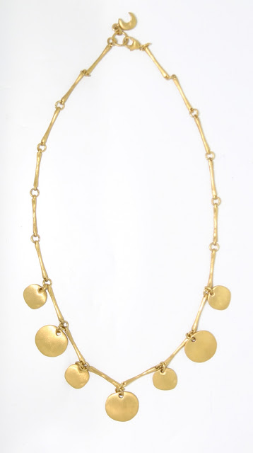Gold disc necklace from Eric Van Peterson, designer jewellery