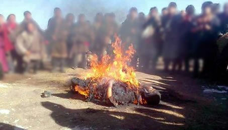 Tibetans gathered watching a man set himself on fire