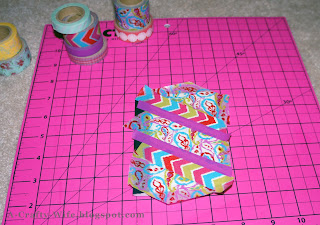 Apply washi tape in pattern of your choice to notebook cover, then wrap edges and carefully trim | A Crafty Wife