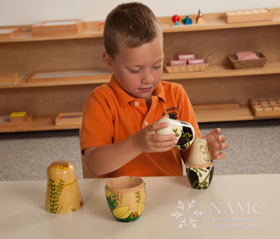 NAMC montessori whole to part lower elementary geography boy with nesting dolls