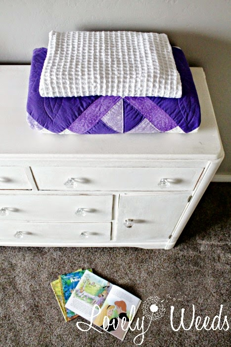 A vintage buffet become a functional dresser/changing table in a baby girl's nursery