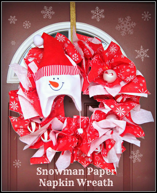 DIY Snowman Christmas Paper Napkin Wreath, done in 15 minutes or less and for less than $5 dollars, this is the wreath to go for a quick festive touch for any season! #wreath #holiday #snowman #Chirstmas