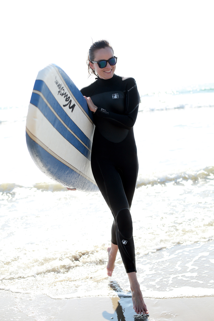 fashion blogger Andy Torres from stylescrapbook surfing in Malibu