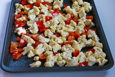 Roasted Cauliflower with Red Bell Pepper, Green Olives, and Pine Nuts (Christmas Caulifiower) found on KalynsKitchen.com