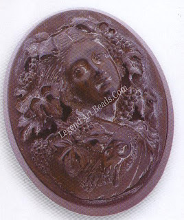 A vulcanite cameo-style brooch. Vulcanite was used to imitate earlier Whitby jet, hence this brooch dates from the late Victorian era, c.189o. The mould marks near the top of the pin indicate vulcanite, which fades with age.