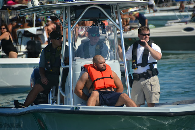guy arrested at Biscayne Bay Columbus Day Regatta 2013