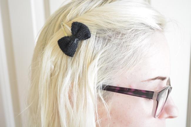 black hair clip in platinum blonde white hair