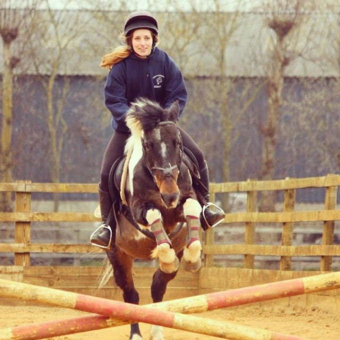 Smiling while Showjumping a little pony