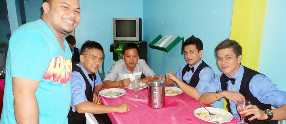 Winson and the Waiters of C & E Catering Services