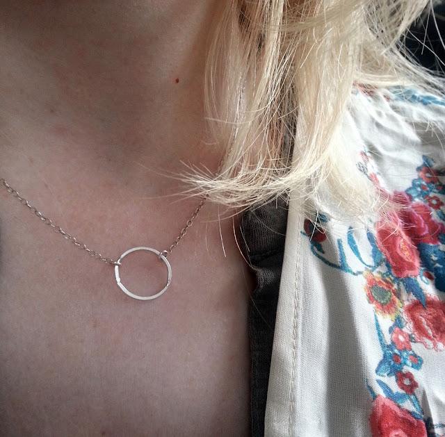 Silver karma circle necklace