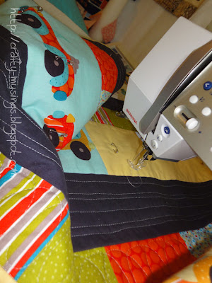 quilting in progress for Vroom quilt
