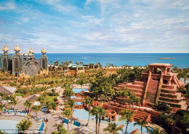 The seaside paradise Aquaventure, which is one of the largest water parks in the world, also has a 131-foot tall Power Tower and a 7-acre snorkeling lagoon, 'People love the Leap of Faith and certainly go through a range of emotions,' said Mark. 'Guests are first and foremost very excited, but typically grow anxious as they wait for their turn. 'Nerves tend to kick in once guests realize they are up next, and after a few minutes of fear and giddy nervousness. 'Then they finally launch themselves down the slide and experience some of the most fun you can imagine. 'It's truly an exhilarating experience.'