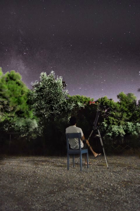 Looking at the stars during summer with my telescope (Astromaster 70AZ). In the island of Rhodes.