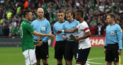 Robbie Keane shakes hands with his English opponents last week in Wembley Stadium.