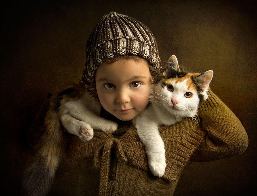 Y con este gato, para qué quiero bufanda