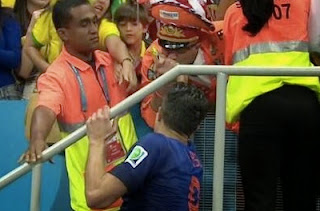 http://purelyfootball.com/2014/07/12/robin-van-persie-gives-world-cup-medal-armband-dutch-fan/